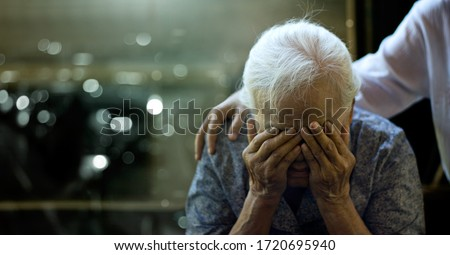 The daughter is comforting an elderly woman who is a mother sadness with Alzheimer's disease and amnesia, Memory loss due to dementia. Royalty-Free Stock Photo #1720695940