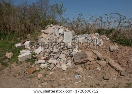 Fly Tipped Builders Rubble on the Side of a Quiet Country Lane in Rural Devon, England, UK Royalty-Free Stock Photo #1720698712