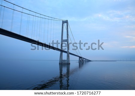 The Öresund or Øresund Bridge is a combined railway and motorway bridge across the Oresund strait between Sweden and Denmark. Royalty-Free Stock Photo #1720716277