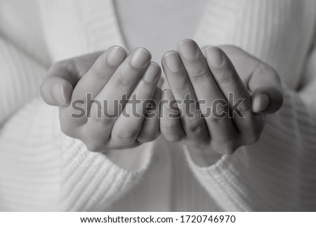 Black and white picture woman open hands, Praying hands with faith in religion and belief in god.