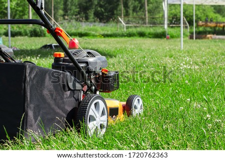 The lawn mower with a grass collector is ready to work #1720762363
