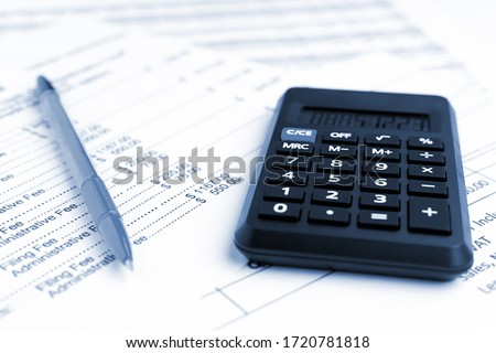 Accounting business concept. Close-up calculator with pen at financial report background. #1720781818