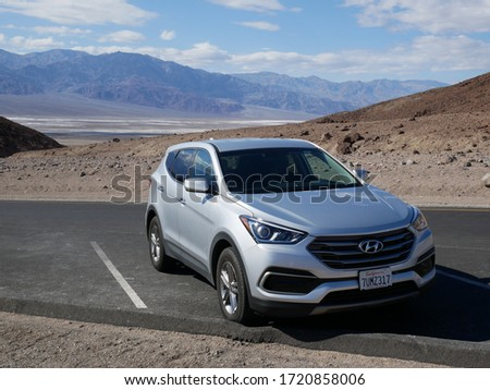 Death Valley, California / USA - 03122018: Having a brake on parking space with the Bed Water in background #1720858006