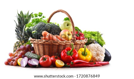 Assorted organic vegetables and fruits in wicker basket isolated on white background. Royalty-Free Stock Photo #1720876849
