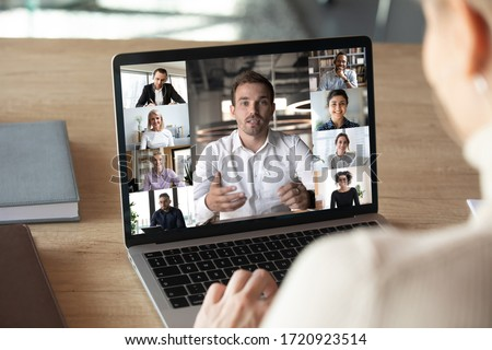 Close up of woman worker talk brainstorm on video call on computer with diverse colleagues, have online team briefing together, female employee engaged in webcam conference on laptop with coworkers #1720923514