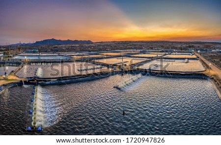 Aerial view of the prawn farm with aerator pump in front of Ninh Phuoc, Ninh Thuan, Vietnam. The growing aquaculture business continuously threatening the nearby wetlands. #1720947826
