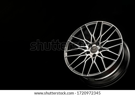 black alloy wheels, aluminum disc sport with a carbon fiber cover. Light weight and modern cool design. copy space maket Royalty-Free Stock Photo #1720972345