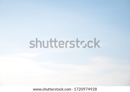 Light blue sky and white clouds background. Royalty-Free Stock Photo #1720974928