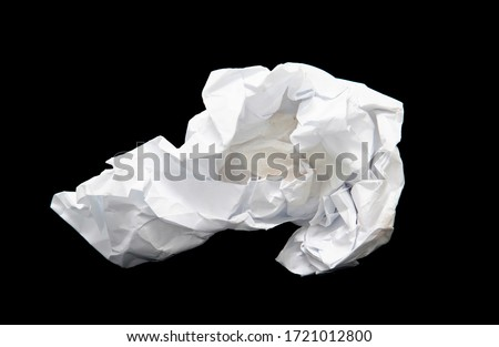 A piece of crumpled white paper on a black background. Royalty-Free Stock Photo #1721012800