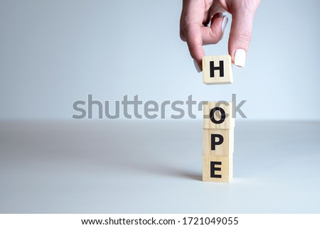 Concept image of Business Acronym HOPE as HAVE ONLY POSITIVE EXPECTATIONS written on wooden cubes. #1721049055