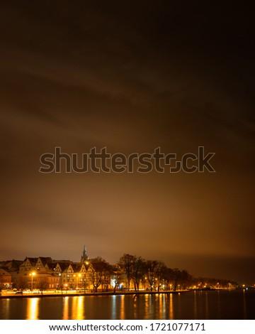 Elk winter panorama. Night photo. Masuria, Poland.