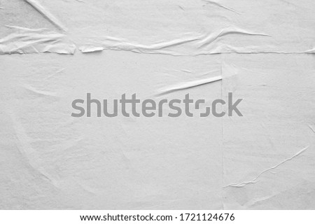 Blank white crumpled and creased paper poster texture background Royalty-Free Stock Photo #1721124676