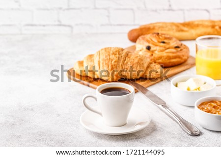 Breakfast with coffee and croissants, selective focus Royalty-Free Stock Photo #1721144095
