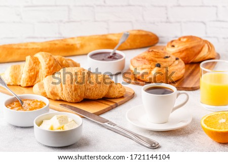 Breakfast with coffee and croissants, selective focus Royalty-Free Stock Photo #1721144104