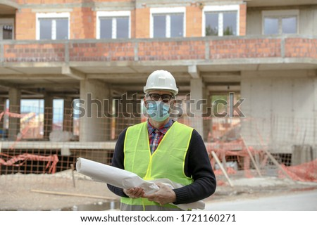 senior architect in front of building #1721160271