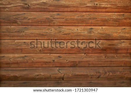 Wooden log cabin texture - interior design in traditional houses. Abstract background with horizontal lines and natural wood pattern with knots on a log wall. Royalty-Free Stock Photo #1721303947