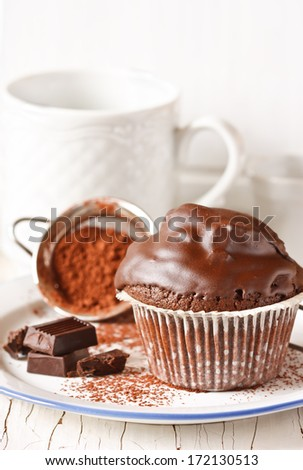 Sweet chocolate muffin on a white plate. #172130513