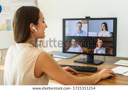 Webinars, online conference, video meeting. A businessman is using app on laptop for video connect with a many people at same time together. Distant work concept #1721351254