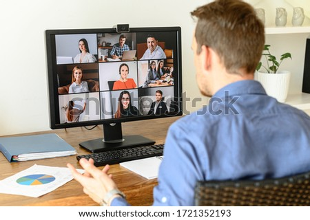Virtual conference with employees. A young man in formal shirt using pc for video call, he has video meeting with several people together. Remote work concept #1721352193