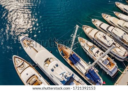 Aerial photo of luxury super yacht marina and sailing boats  Royalty-Free Stock Photo #1721392153