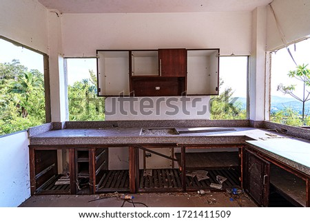 Abandoned and destroyed house in the jungle forest. Destroyed kitchen with the palm tree forest view. Thailand hotel destroyed and without people. Royalty-Free Stock Photo #1721411509