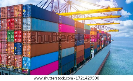 Container ship unloading in deep sea port, Global business logistic import export freight shipping transportation oversea worldwide container ship, Container vessel loading cargo cargo freight ship. #1721429500