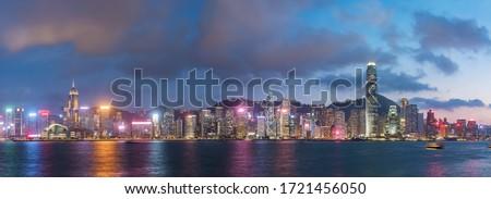 Panorama of Victoria harbor of Hong Kong city at dusk