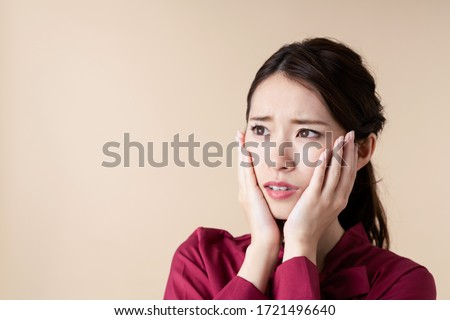 Worried young asian woman. Facial expression. #1721496640
