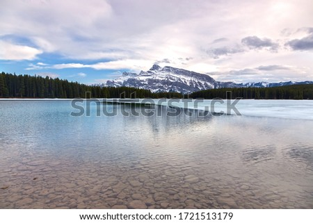 Two Jack Mountain Lake Early Springtime Scenic Landscape View. Banff National Park, Alberta, Canadian Rocky Mountains Royalty-Free Stock Photo #1721513179