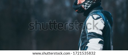 Biker in protective suit with a helmet. Royalty-Free Stock Photo #1721535832