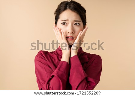 Worried young asian woman. Facial expression. #1721552209