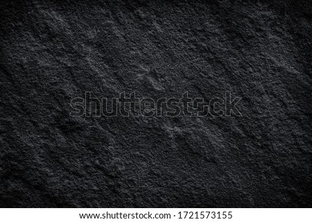 natural black stone texture or dark grey black slate background. abstract black stone pattern.