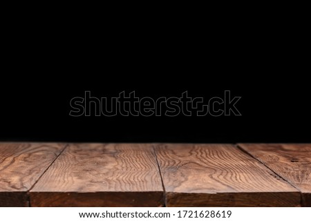 Blank wooden deck table against black wallpaper background for present product and other things. Can be used for your creativity. #1721628619