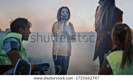 Team of Paramedics Perform Emergency First Aid to Injured Young Girl. Giving Oxygen Mask and Checking for Injuries. Car Crash Traffic Accident Royalty-Free Stock Photo #1721662747