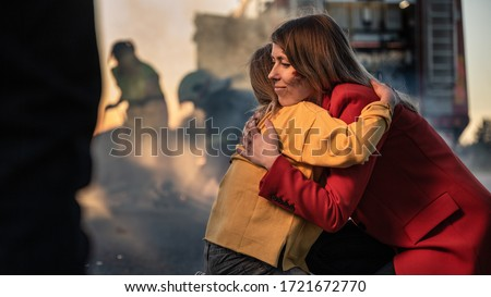 Car Crash Traffic Accident: Injured Young Girl Reunites with Her Loving Mother. In the Background Fire engine and Courageous Paramedics and Firemen Save Lives Royalty-Free Stock Photo #1721672770