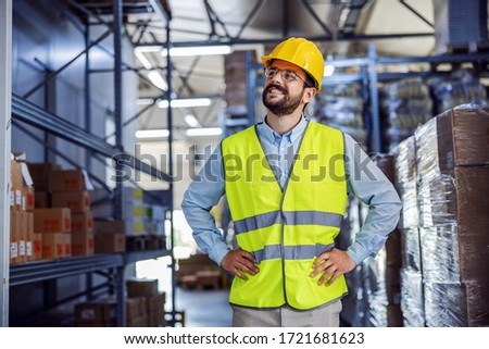 Low angle view of successful proud businessman standing with hands on hips and looking around his factory. #1721681623