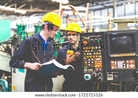Two electrician Man Worker at industrial factory wearing uniform and hard hats and Mechanical repair.  Engineer Operating  lathe Machinery #1721715526