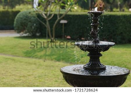 Outdoor water fountain for garden decoration Royalty-Free Stock Photo #1721728624