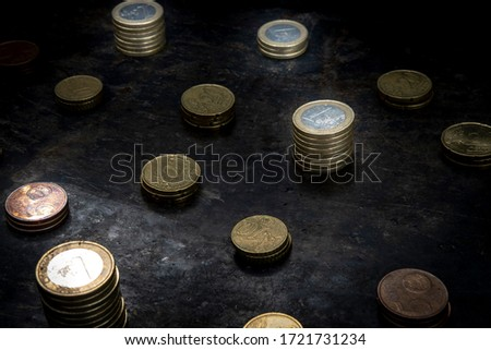 mosaic with a regular pattern made up of euro coins on a dark black background with ripped metal details #1721731234