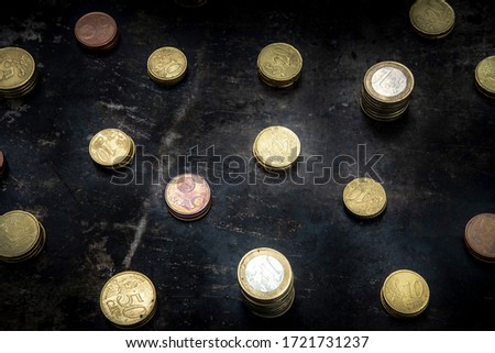 mosaic with a regular pattern made up of euro coins on a dark black background with ripped metal details #1721731237