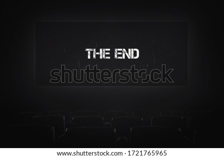 Empty Cinema, End Of Film. Captions On Screen After Show Film. Failure In Film Distribution. inscription the end. problems in the movie business due to the corona virus outbreak Royalty-Free Stock Photo #1721765965