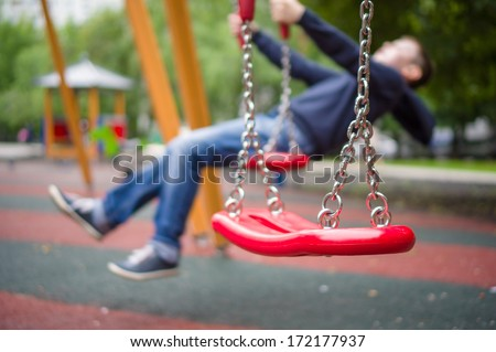 Set of red chain swings on modern kids playground #172177937