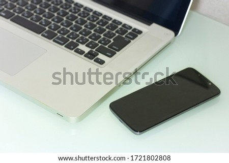 laptop and mobile phone on desk #1721802808