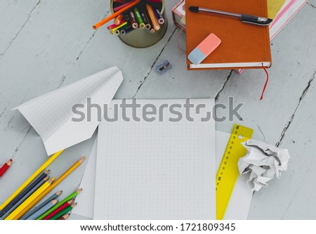 School, education. Book with pencils on the table #1721809345