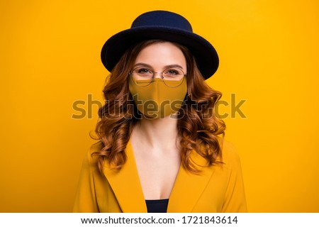 Close-up portrait of her she nice-looking charming cute lovely cheerful wavy-haired lady protect covid-19 wearing medical mask yellow blazer isolated on bright vivid shine orange background Royalty-Free Stock Photo #1721843614