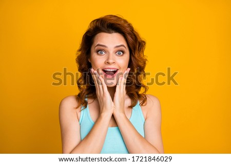 Closeup photo of pretty shocked curly foxy lady good mood open mouth unbelievable sale shopping arms on cheeks wear teal casual tank-top isolated bright yellow color background #1721846029