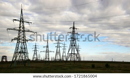 The clouds over the power lines are magnificent.Power lines and sky with clouds.Powerful lines of electric gears.Electric power industry and nature concept.High voltage power lines. #1721865004