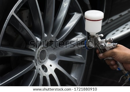 Sprayed ceramic alloy coating with air brush equipment. Royalty-Free Stock Photo #1721880910