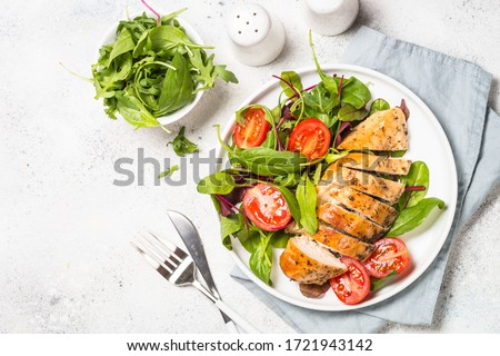 Chicken fillet with salad. Healthy food, keto diet, diet lunch concept. Top view on white background. #1721943142