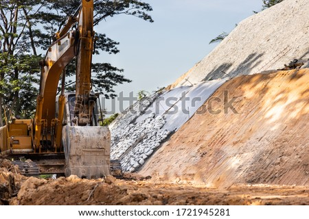 Slope retention construction work being carried out to manage landslide in highland Royalty-Free Stock Photo #1721945281